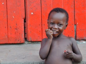 child w red wall web Fourth and final day in Ghana