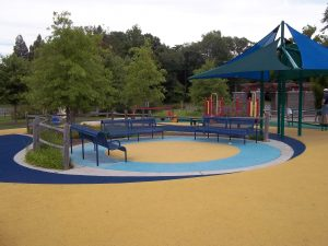 gathering area 300x225 Site amenities can enhance the playground experience for everyone