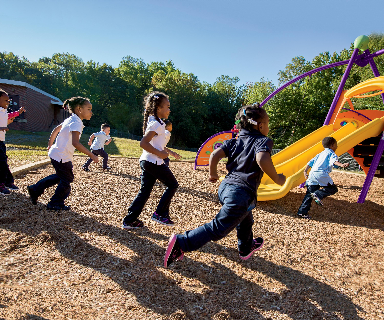 Photo - Kids running towards Activo Bambino playground
