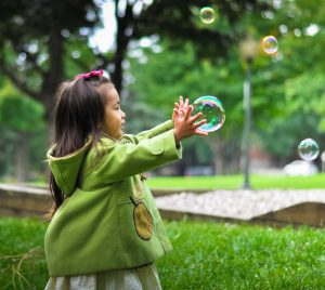 Toddler Playing With Bubbles