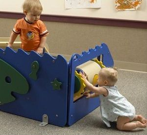 Infants playing on indoor playground